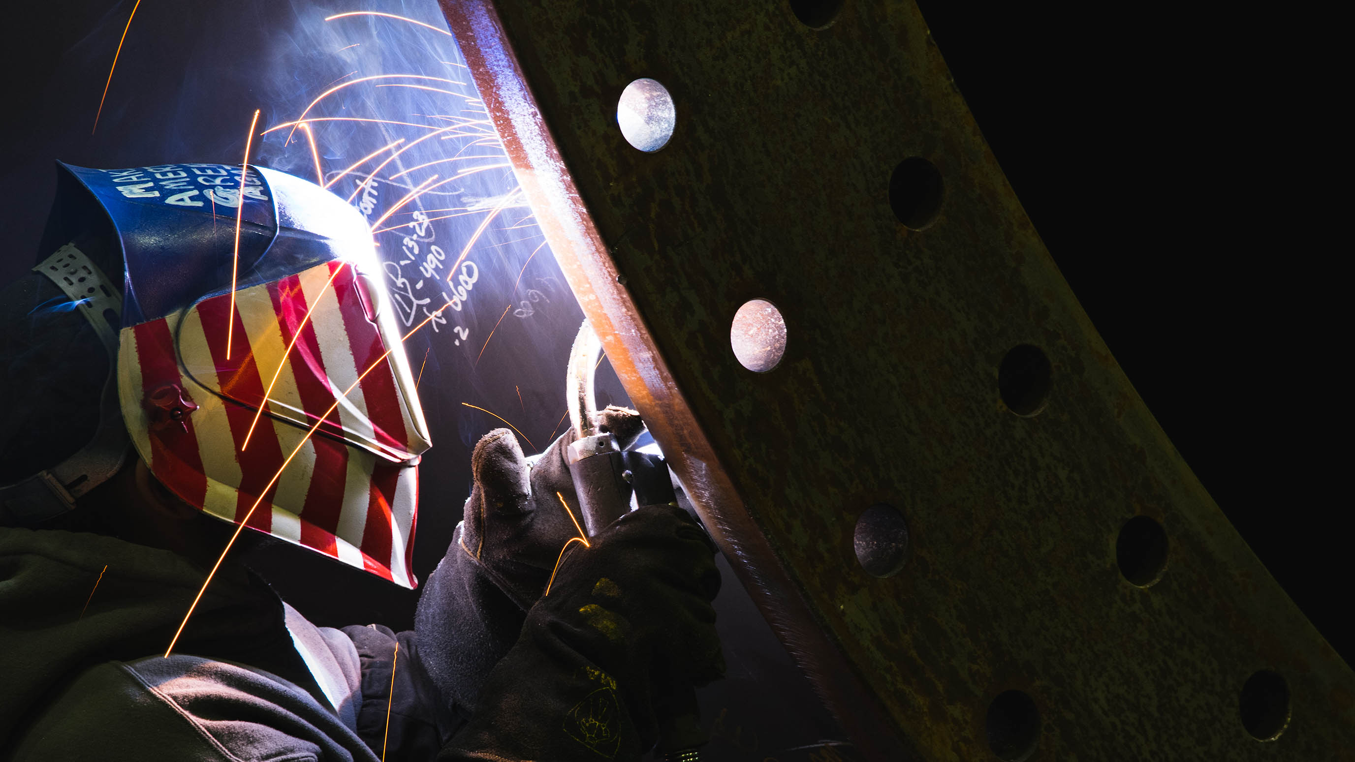 Welder works on turbine tower