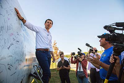 Pete Buttigieg Signs Turbine Blade